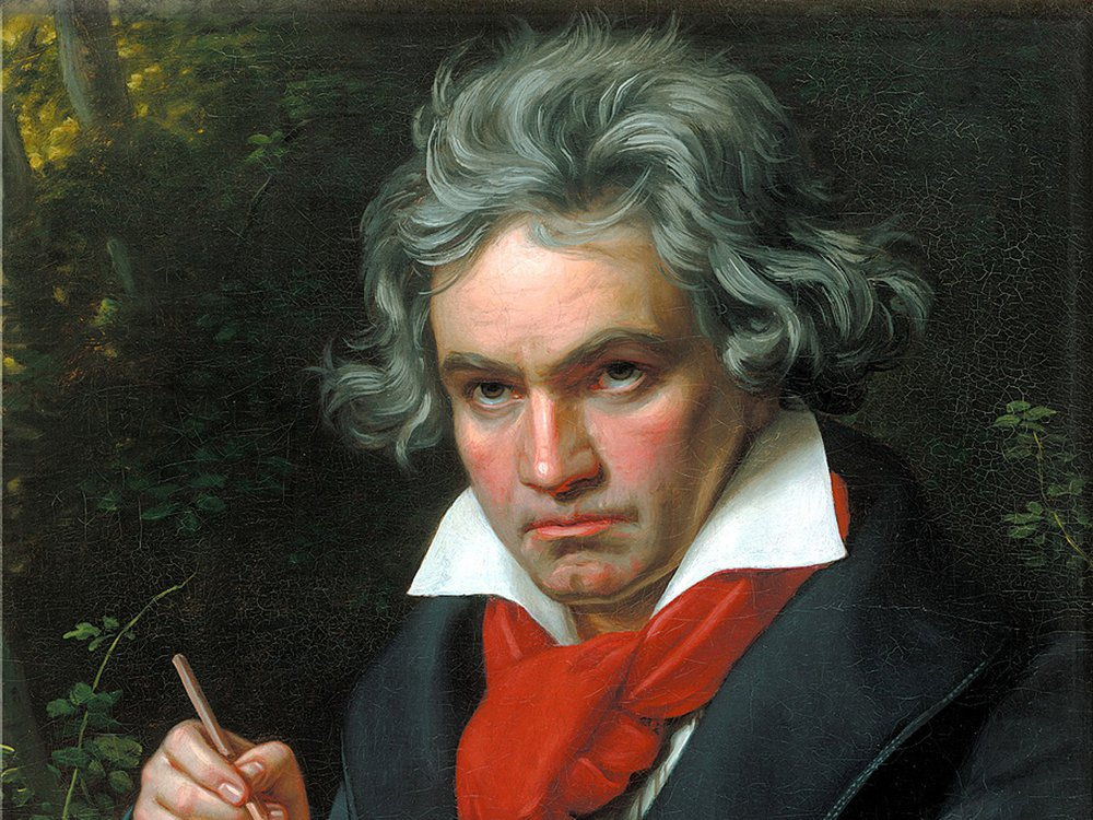 A portrait of Beethoven, a white man with reddish cheeks holding a musical score and a pencil in his hand, wearing a red scarf around his neck with tousled, unruly hair