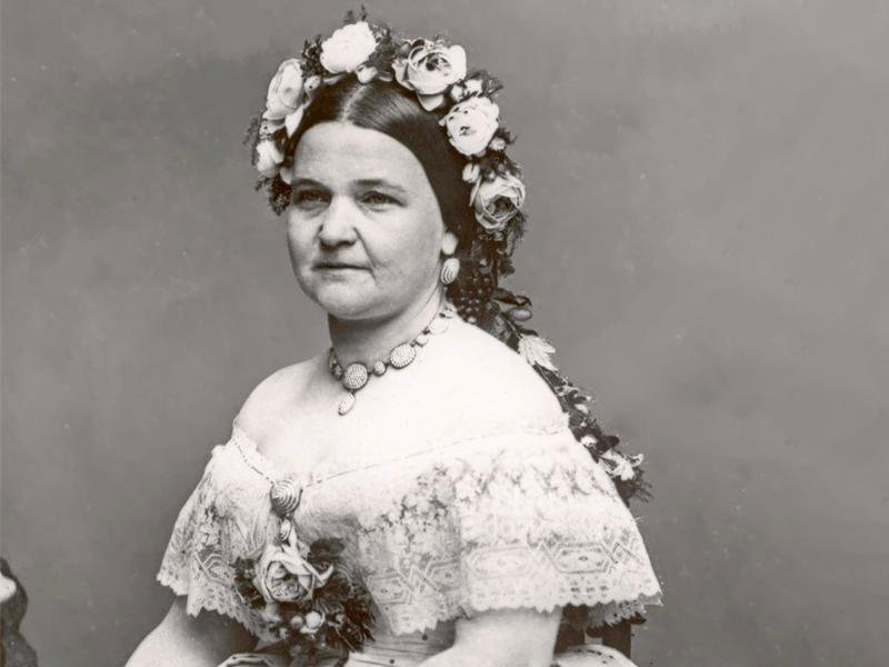 A black-and-white portrait of Mary Lincoln wearing flowers in her hair
