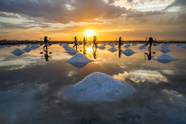I came here in the colorful afternoon. The sun is going down, preparing hide under far away mountain peaks. The people was harvesting salt by traditional way. This is  a such hard work job. thumbnail