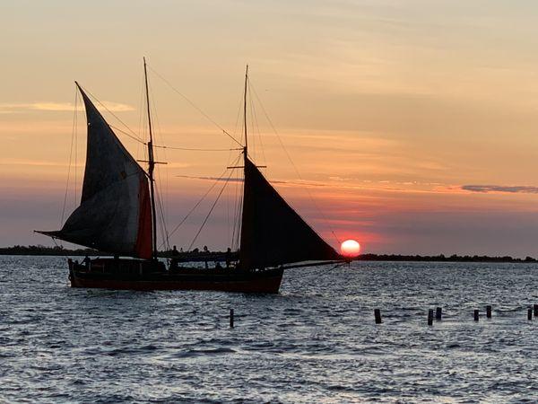 Boat Sailing Past at Sunset thumbnail