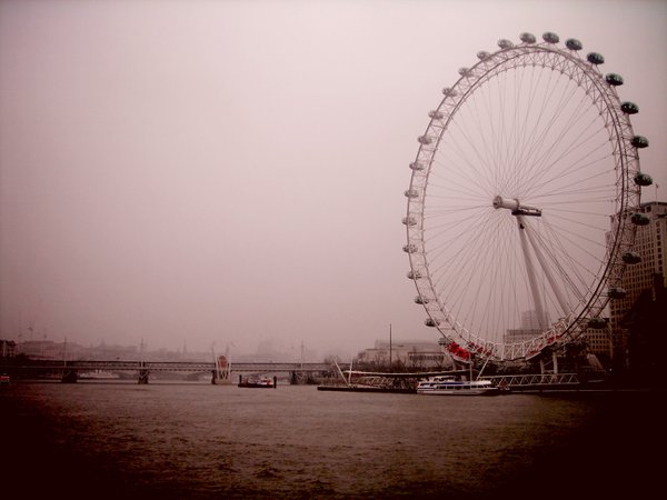 The London Eye from a boat on the Thames on a rainy day thumbnail