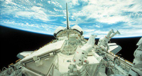 Astronauts float in zero gravity outside the Challenger space shuttle in 1984.