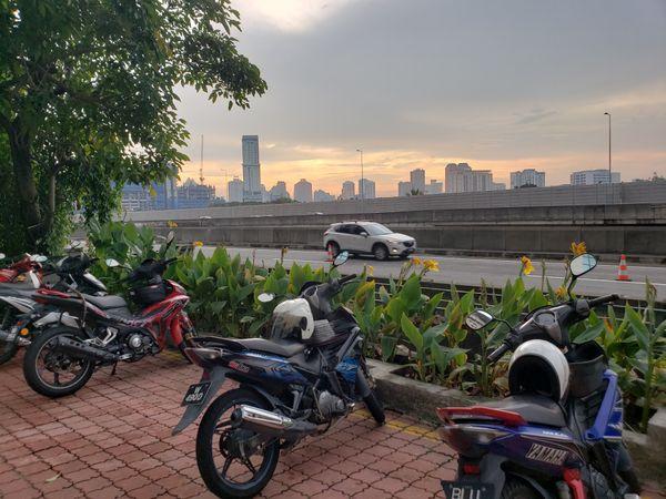 Sunset while walking in kuala Lumpur sidewalks thumbnail