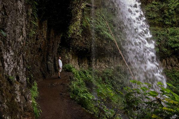 Underneath a waterfall thumbnail