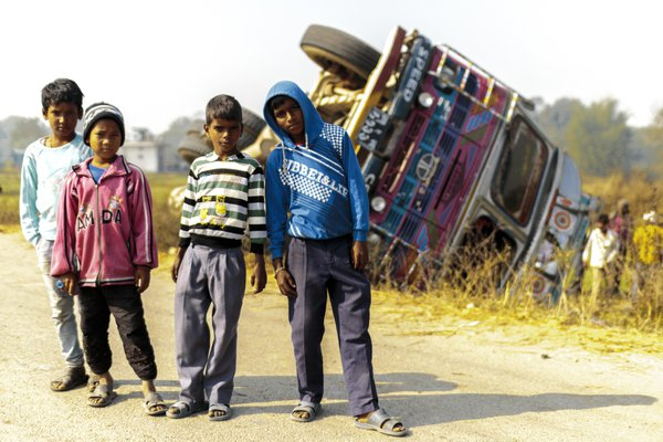 Nepali juniors playing in front of a crashed truck thumbnail