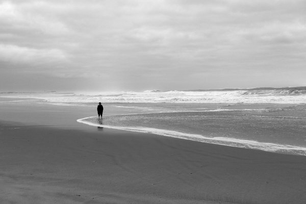 Woman at the beach in a rainy day thumbnail