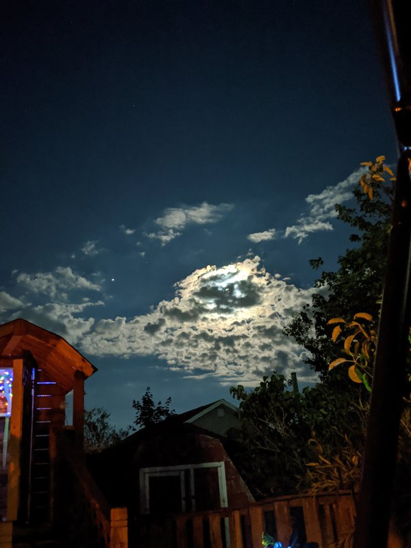 Full moon in clouds thumbnail