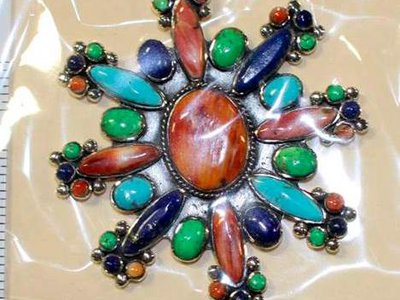 Undated photo provided by U.S. Fish and Wildlife Service shows fake Native American styled-jewelry seized by federal officials during a 2015 investigation in New Mexico.
