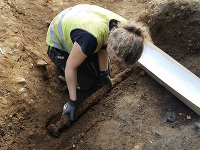 The 1,100-year-old sword found in Norway measures about three feet long.
