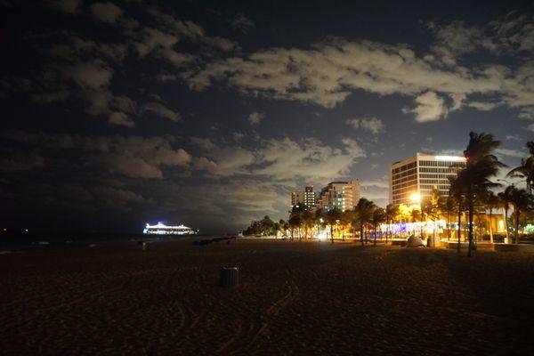 A cruise ship docking before sunrise. thumbnail