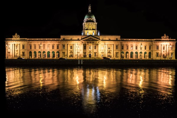 Parliament of Dublin reflected on Liffey river thumbnail