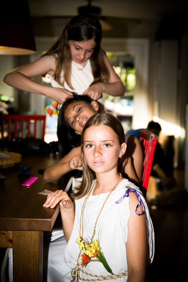 """A shot of my daughter with two friends preparing for their 6th grade """"Roman"""" themed graduation. thumbnail"""