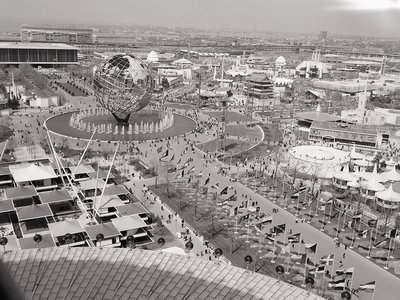 An overhead view of the 1964 World's Fair, showing the unisphere and surrounding pavilions.
