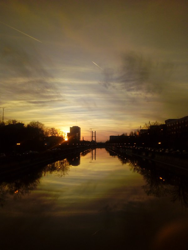 A beautiful afternoon sunset sky over a river in Bucharest thumbnail