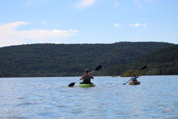A Dad teaching his son to Kayak thumbnail
