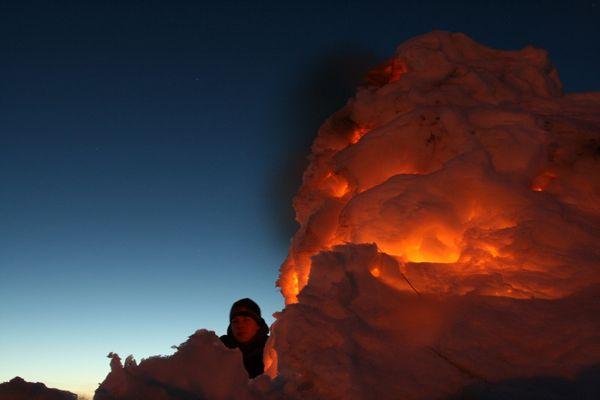 boy by firelit snowcave thumbnail