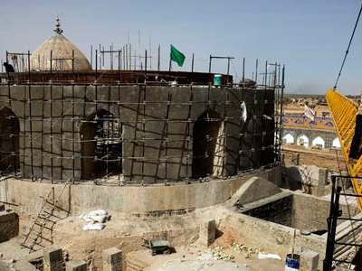 Scaffolding covers the reconstructed golden dome. With help from the U.N. and the Iraqi prime minister's office, workers are rebuilding the sacred Shiite site.