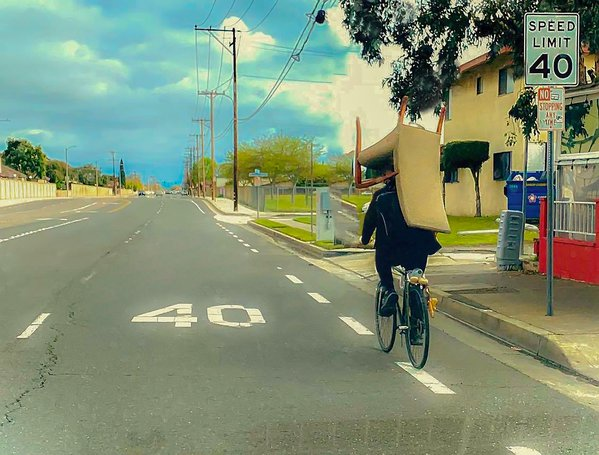 Moving a sofa by bicycle. thumbnail
