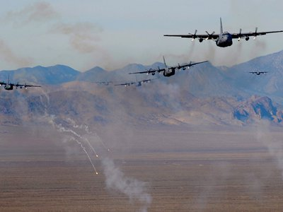 U.S. Air Force C-130 Hercules aircraft fire chaff and flare countermeasures over the Nevada Test and Training Range Nov. 17, 2010.