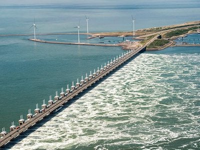 The Oosterscheldekering (Eastern Scheldt storm surge barrier), between the islands Schouwen-Duiveland and Noord-Beveland, is the largest of the 13 ambitious Delta Works series of dams and storm surge barriers, designed to protect the Netherlands from flooding from the North Sea.