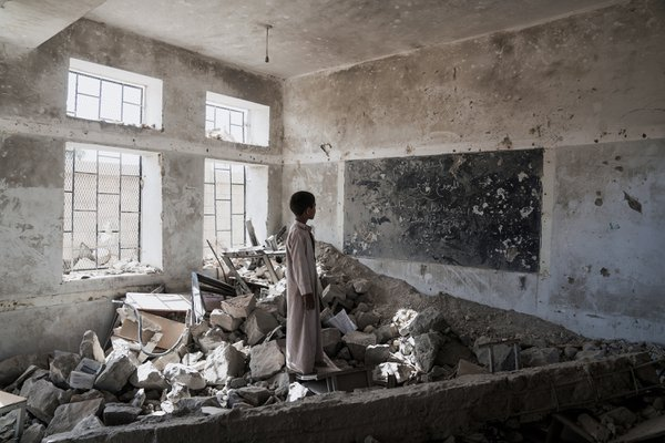 Yemeni Student In A Bombed Out Classroom thumbnail