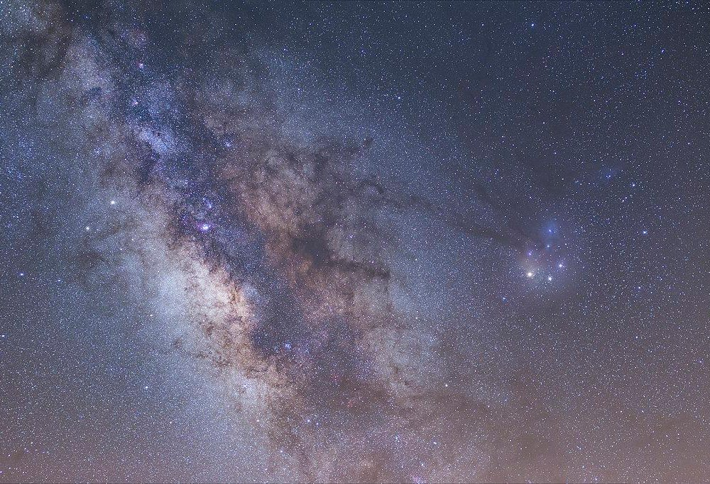 A pastel blue, purple and pink image of the Milky Way