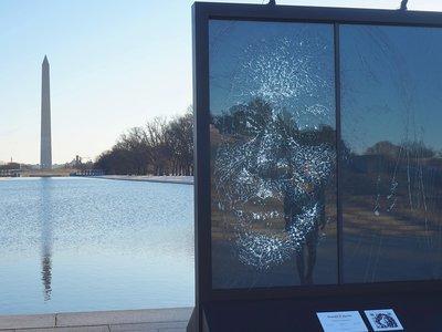 Artist Simon Berger created the portrait by strategically hammering cracks into a pane of glass.