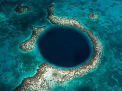 This sinkhole in Belize has drawn scientists and divers, shedding light on the mystery that ended the Mayan Empire.