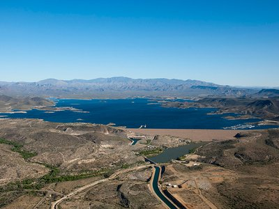 Water-strapped cities with growing populations and energy needs could benefit the most. Greater Phoenix, for instance, is served by this reservoir and irrigation system fed by the Colorado River.
