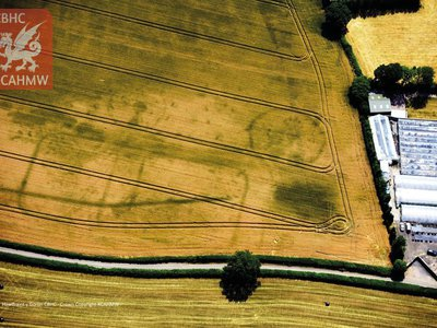 The hot, dry summer of 2018 revealed the long-lost outlines of Roman forts and roads in Wales. This photo shows a Roman fort discovered near Carrow Hill.
