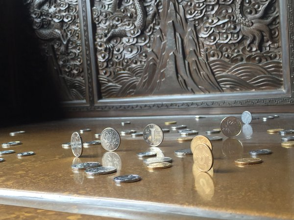 Coins on a stone chair thumbnail