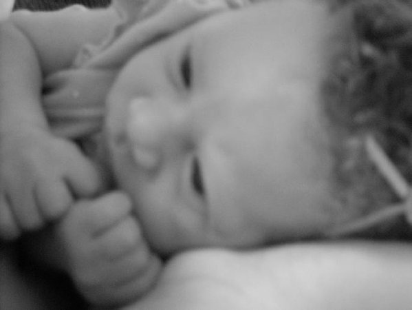 Baby opens her eyes to the strange world around her. thumbnail