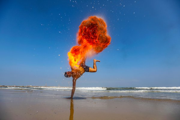 Palestinian men perform fire breathing on the beach in Gaza City on August 8, 2019 thumbnail