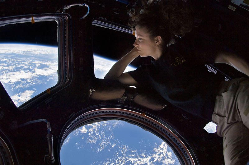 Astronaut Tracy Caldwell Dyson in the ISS' Cupola, where a micrometeorite hit the window last year.