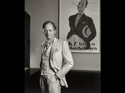 """""""Part of [Wolfe's] skewering of society was to also be absolutely his own man,"""" says National Portrait Gallery curator Brandon Brame Fortune. """"For him, that meant wearing this white vanilla colored three-piece suit wherever he went."""""""