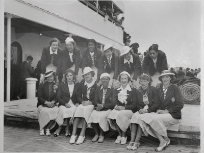 A few of the Olympians pose for a photo upon their return to the U.S. after the 1936 Games. In the back row, on the far right is Tidye PIckett and third from the left is Louise Stokes.