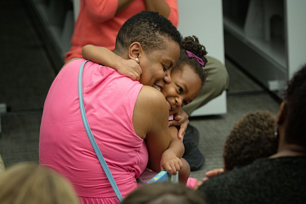 Parent and child embrace