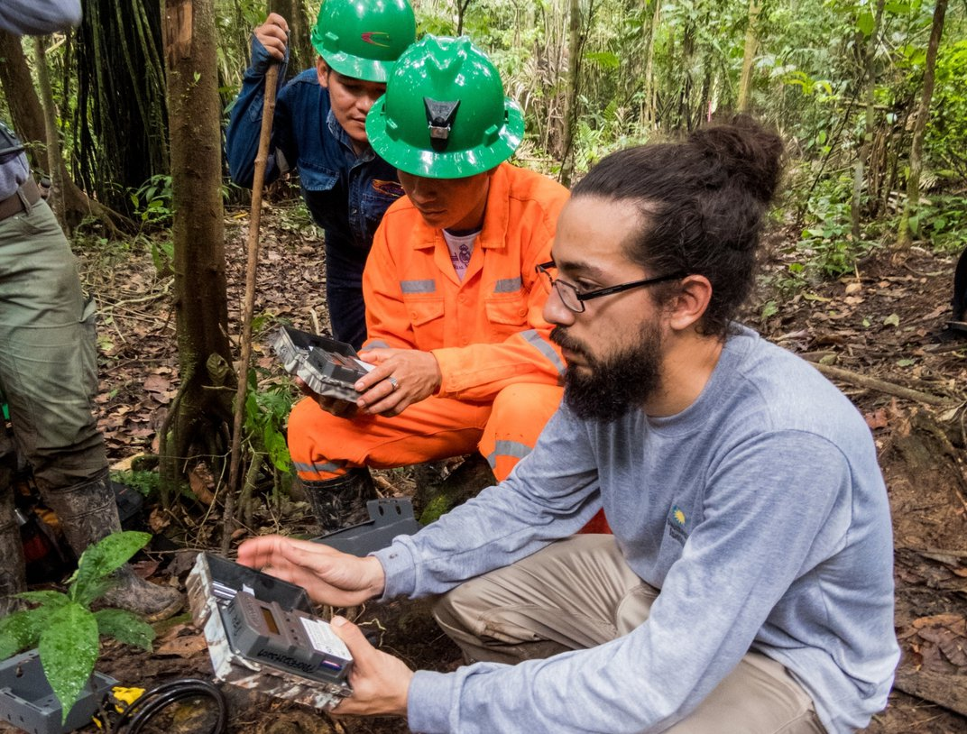 Diego Balbuena, research assistant with the Smithsonian Conservation Biology Institute's Center for Conservation and Sustainability, trains local partners in the use of camera traps