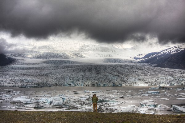 My son is dwarfed by the looming majesty of a glacier at Fjallsarlon, Iceland.  I couldn't have asked for a better backdrop. thumbnail