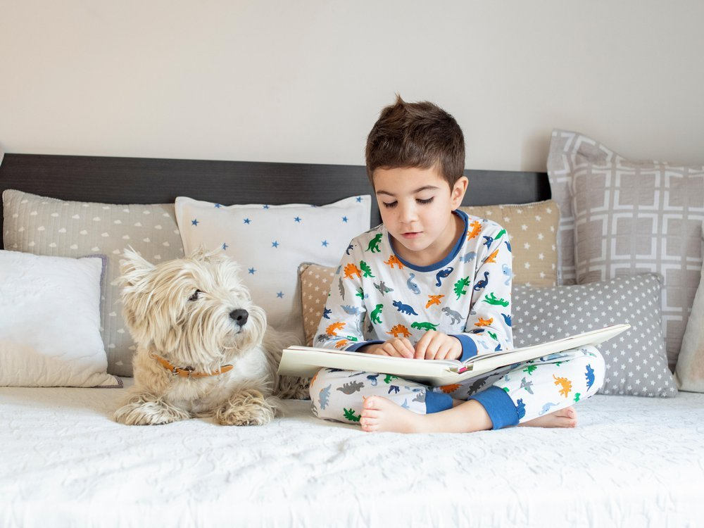 Boy reading with his dog