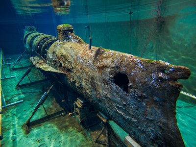 The H.L. Hunley, a confederate Civil War era submarine, sits in its water tank at the Hunley Lab in North Charleston, SC.