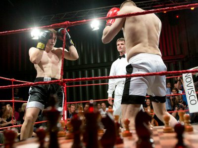 A chessboard awaits the next round just outside the ring during a chessboxing match in Berlin in 2012