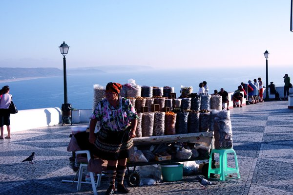 Woman selling food in Nazare, Portugal thumbnail