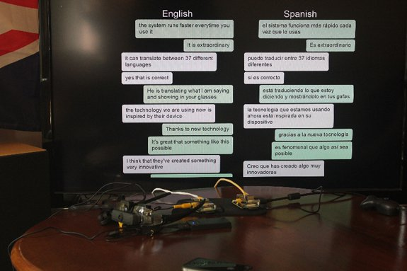 The translated conversation is displayed on a monitor.