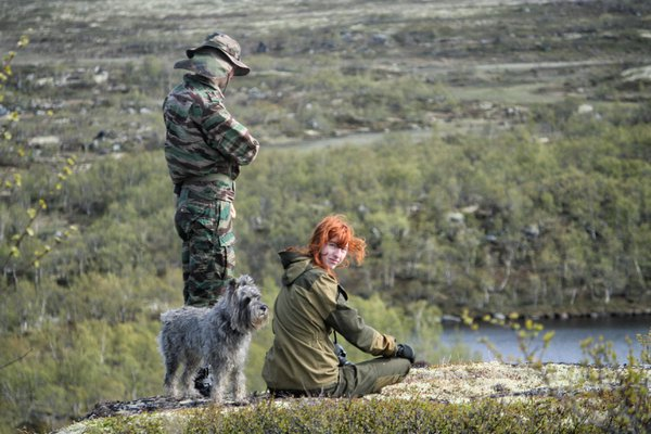 A woman, a man and a dog on the background of the tundra thumbnail