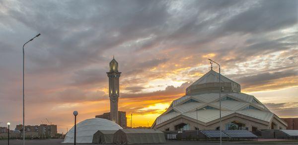 New futuristic mosque at sunrise thumbnail