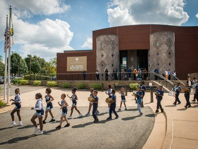 Garfield Elementary's award-winning drumline performs with the cheerleading squad in celebration of the Anacostia Community Museum's 50th anniversary.