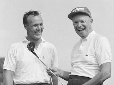 Dwight Eisenhower and Arnold Palmer smile before a round of golf at the Gettysburg Country Club in Gettysburg, Pennsylvania, in 1960.