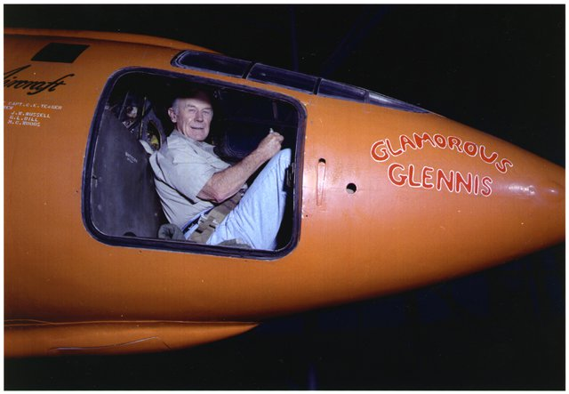 74 year old Chuck Yeager in cockpit of orange Bell X-1