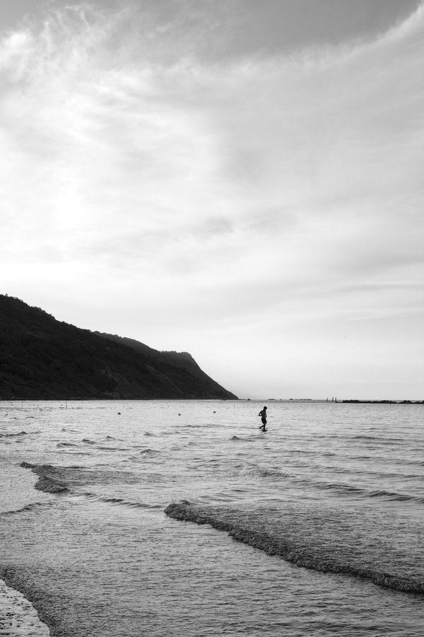 Kid walking in the shallow water (b/w) thumbnail